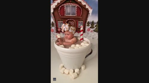 Adorable Baby Sits in Cup of 'Hot Chocolate' Eating Marshmallows