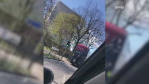 Video Shows Young Person Performing Dangerous Act By Hanging Onto Back of Speeding Bus