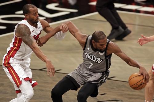 Harden, Durant help Nets break away late, beat Heat 98-85
