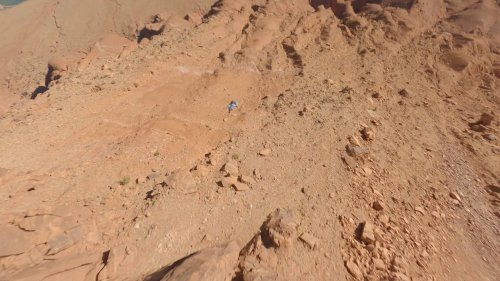 Wingsuit Jumper Soars Over Desert Captured by FPV Drone