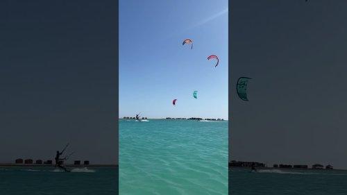 Kite Surf Duo Mess Around in Water