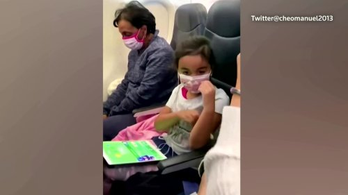Young girl receives birthday treat on flight