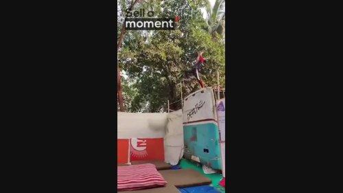 Parkour guy lands backflip off rooftop