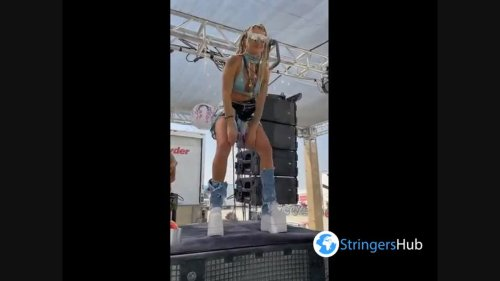 Unusual girl dancing on the subwoofer at Burning Man in Black Rock Desert, Nevada, USA