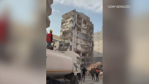 Onlookers Flee as Demoed Building Accidentally Crashes Into Another Building