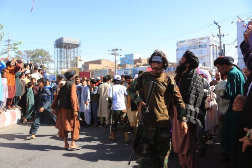 Witness: Taliban hang dead body in Afghan city's main square