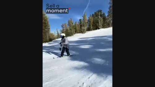 Smooth Snowboarder Performs 360 Backside