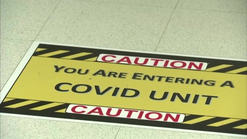 U.S. to keep COVID travel curbs as cases climb