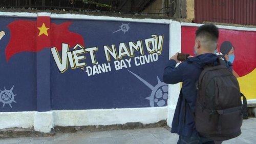 Murals on COVID-19 prevention hit Hanoi street