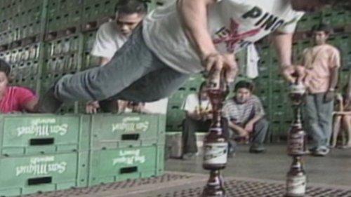 Manila Man Balances on Beer Bottles to Do Push-Ups
