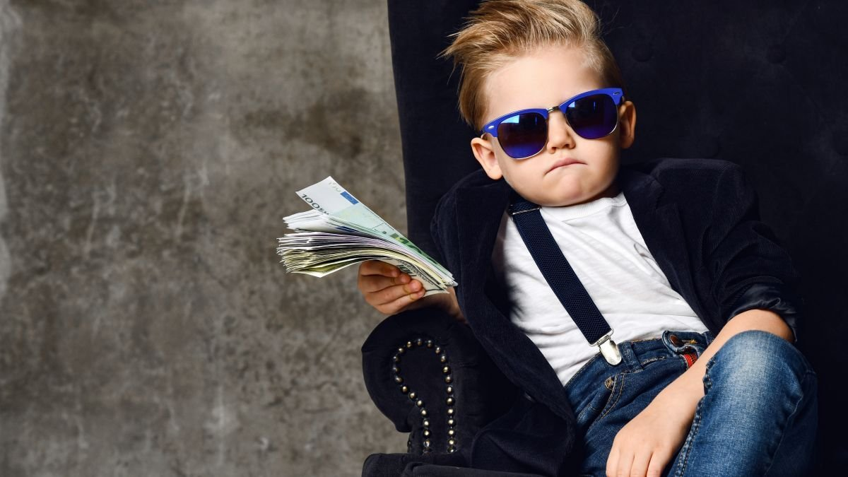 An Age-By-Age Guide to Teaching Kids About Money