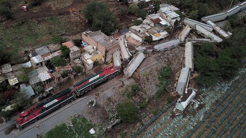 Derailed freight train that crushed homes and killed one person
