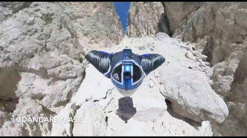 Daredevil soars over the Italian Alps in a wingsuit!