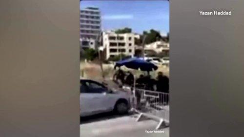 Car rams Israeli police, driver shot dead