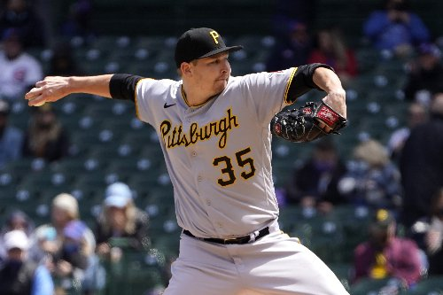 Davies, Pederson lead Cubs over Pirates 3-2, 4th win in row