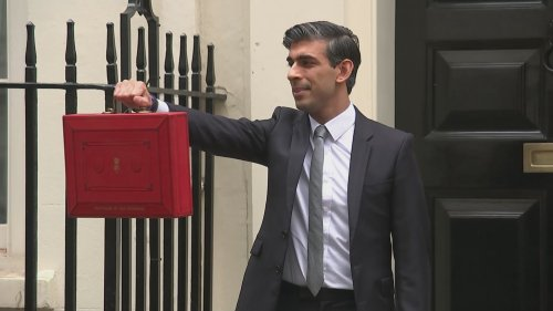 Chancellor poses with red despatch box ahead of Budget