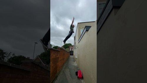Parkour fanatic performs comical cat leap