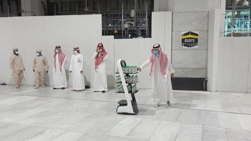 Robots distribute holy water in Mecca amid Covid hajj precautions