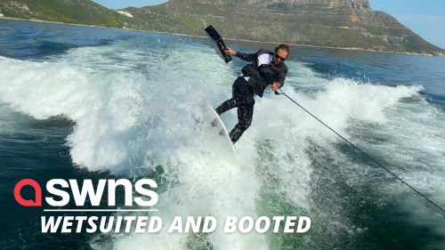 Stylish businessman wearing a suit rides his WAKEBOARD home from work (RAW)
