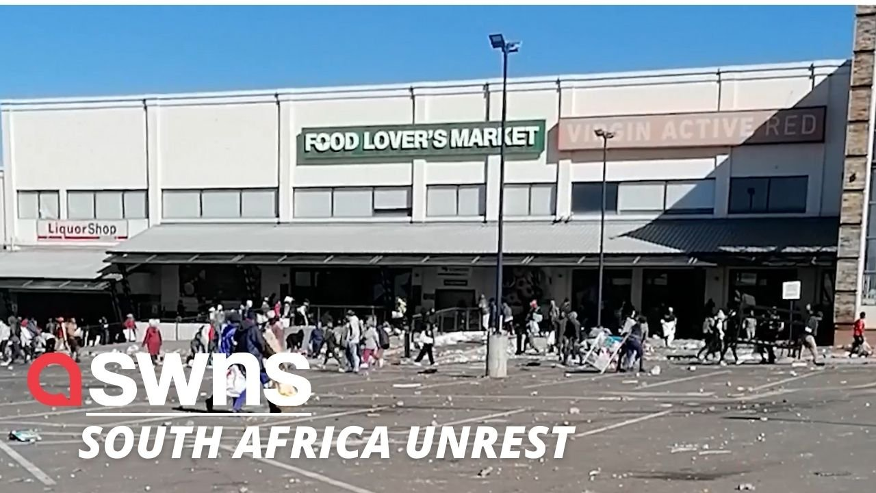 Shocking video shows a crowd of people LOOTING a shopping centre in Soweto as unrest grips South Africa