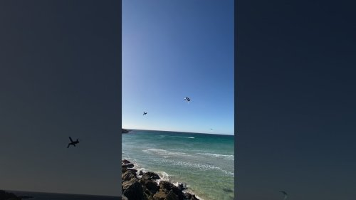 Kitesurfer gets lifted off ocean surface