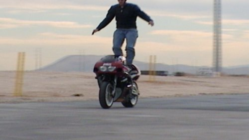Motorcyclist Dances on the Seat of His Bike, Then Loses Control