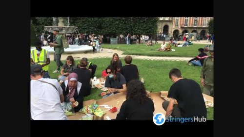 At Place des Vosges in Paris, France volunteers set up tents for the homeless