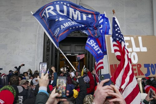 US intel report warns of more violence by QAnon followers