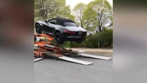 Auto Annihilation! Video Shows Jaguar Smashing Into Truck After Not Being Properly Secured!