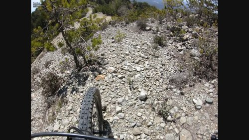 MTB rider goes down impossible ridge in POV