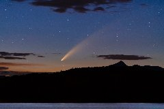 Discover comet passing