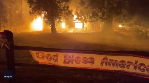'God Bless America' Sign Billows in Wind as Wildfire Rips Through Californian Town
