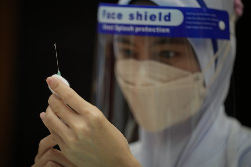 The Latest: Czech Republic begins giving 3rd vaccine doses