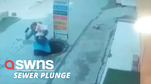Woman and child rescued after plunging down an open manhole cover