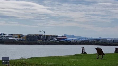 Reykjavik Residents Enjoy a Sunny Beach Day as Volcano Erupts in the Distance
