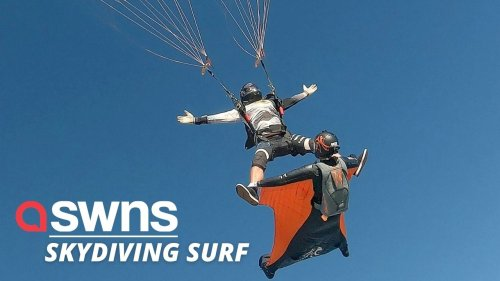 This impressive docking stunt shows the moment a parachuting athlete SURFS on the back of a wing suit pilot (RAW)