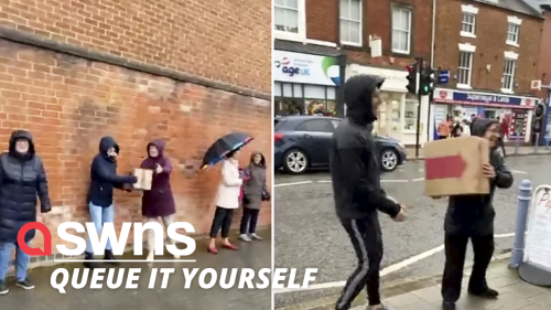 Shoppers form human chain to help store moving up the street