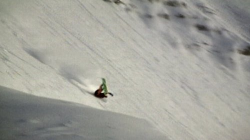 Snowboarder Takes a Massive Spill and Still Lands on His Feet
