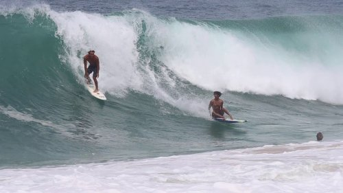 Surfing Duo Avoid Collision But Wiped By Big Wave