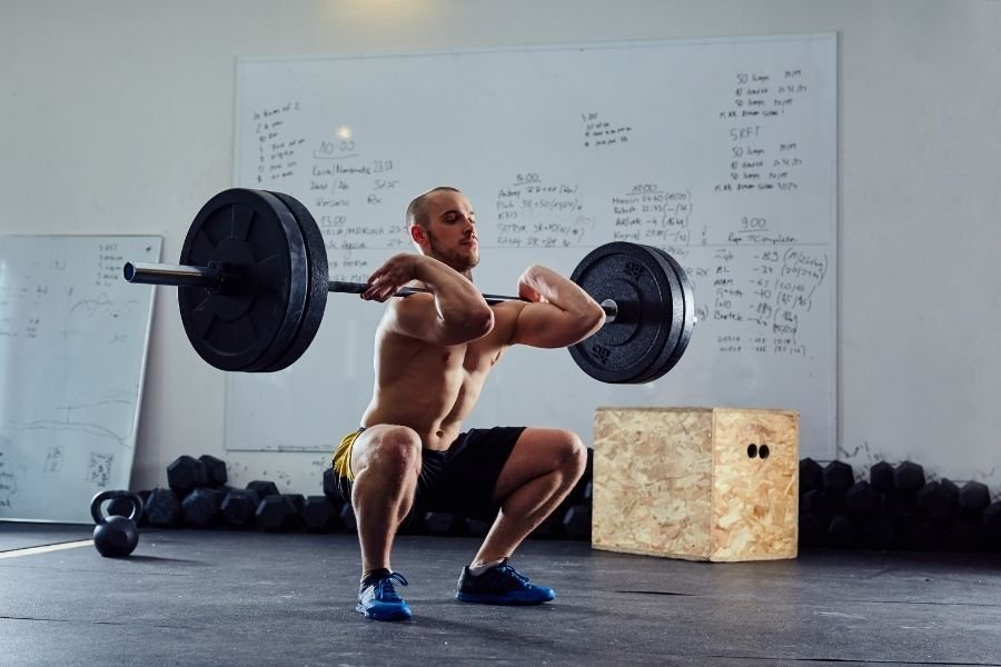 The Proper Way to Do a Squat, According to Experts