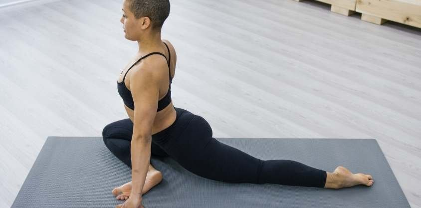 9 Yoga-Based Hip Stretches to Reverse the Damage of Sitting Down