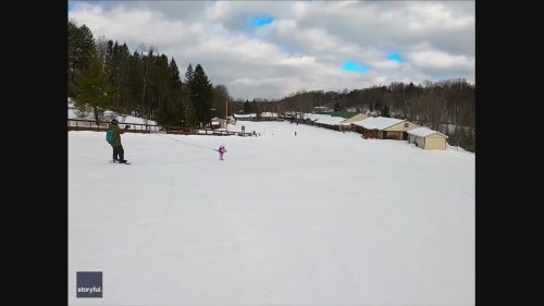 Tethered Toddler Hitches a Ride While Learning to Snowboard
