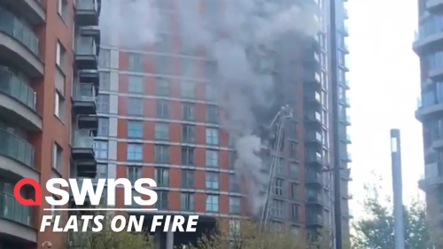 Fire tears through an apartment block in London - as 125 firefighters tackle the blaze (RAW)