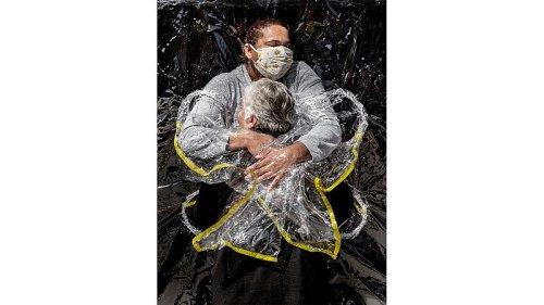 World Press Photo: Image of Brazil nursing home hug wins 2021 award
