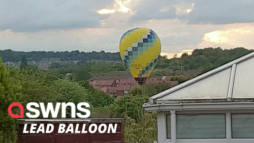 The moment hot air balloon misses target and lands in HOUSING ESTATE in UK - RAW