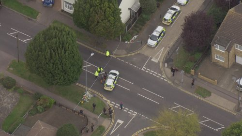 Aerials of police presence and mourners in Leigh-on-Sea