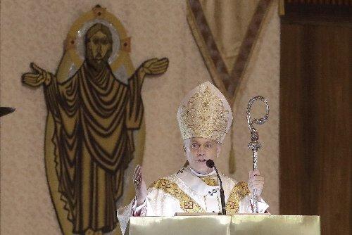 2 Catholic bishops at odds over Biden receiving Communion