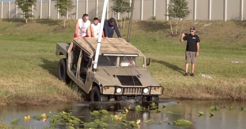 Watch This Humvee Go Completely Underwater Attempting 12-Ft-Deep Pond Crossing