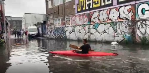 Kayaker paddles down flooded London street after torrential rain hits UK capital