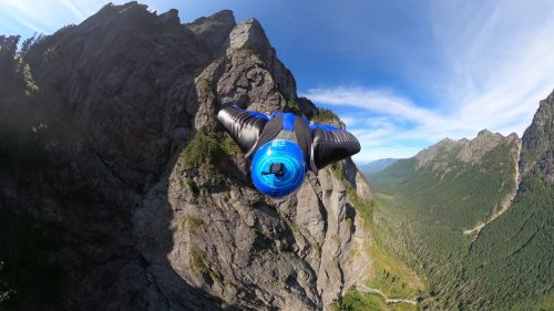 Bold Skydiver Swerves through Mountainous Range